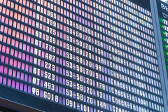 Close up departure board in airport background stock photo