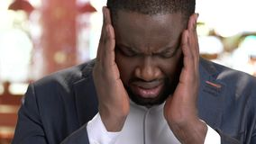 Close up depressed businessman suffering from headache. Afro-american guy in formal wear having terrible headache close up. Face of sick man stock video