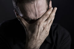 Close up of depressed and despaired man. Royalty Free Stock Photo