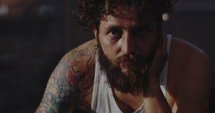Depressed drug addict looking at camera. Close-up of a depressed drug addict looking at camera stock footage