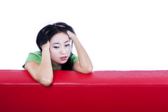 Close-up depressed female on red sofa - isolated Stock Photos