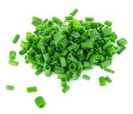 Close-up desbastado das cebolas verdes isolado em um branco Imagens de Stock
