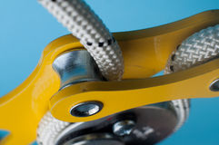Close-up of descender on the rope. Close-up of safety equipment for descent on the rope, using in Climbing, Urban climbing, working on height, Speleology Stock Photography