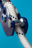 Close-up of descender on the rope. Close-up of safety equipment for descent on the rope, using in Climbing, Urban climbing, working on height, Speleology Stock Photo