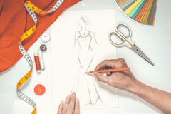 Close-up of designer drawing a fashion sketch.  Stock Photos
