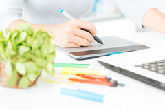 Close up designer using graphic tablet design. On desk Royalty Free Stock Image