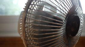 Close up of desktop fan blowing and rotating towards camera. July 29 2018 stock video
