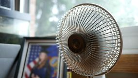 Close up of desktop fan blowing and rotating towards camera V2. July 29 2018 stock video footage