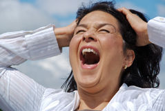 Close up of desperate screaming woman stock images