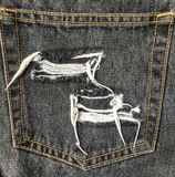 Close up of destroyed torn denim  jeans patch Royalty Free Stock Photo