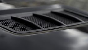 Close up for detail of air vents on the bonnet of a modern black car. Stock. Car exterior background detail of air. Close up for detail of air vents on the royalty free stock images