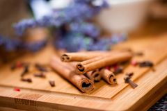 Close up detail of aromatic cinnamon sticks and tea ingredients Royalty Free Stock Images