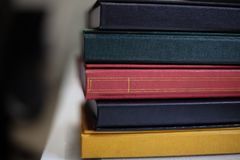 Close up of bespoke book covers at a book binder. Close up detail of bespoke book covers at a book binder with several books of assorted colors and textures stock images