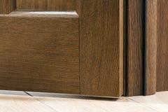 Close-up detail of brown wooden door.  Stock Photography
