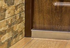 Close-up detail of brown wooden door.  Stock Image