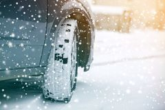 Free Close Up Detail Car Wheel With New Black Rubber Tire Protector On Winter Snow Covered Road. Transportation And Safety Concept Royalty Free Stock Photo - 151772345