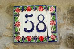 Close up of  detail of ceramic tiles. Of a house number fifty eight royalty free stock photos