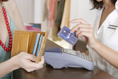 Close up Detail of Client Making Payment by Counter Royalty Free Stock Photo