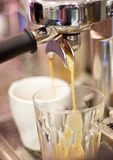 Close up detail of a coffee machine. Dispensing coffee into two cups Royalty Free Stock Image