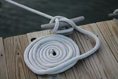 Coiled Rope and Dock Cleat Stock Photography