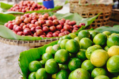 Close-up detail of colorful limes on Asian market Stock Photo