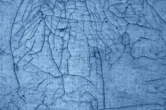 Close-up detail of cracked paint on wall. black - blue Royalty Free Stock Image