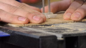 Close up of detail cutting with motosaw stock footage