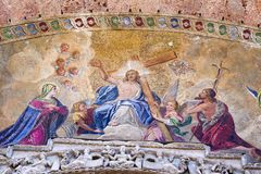 Close up detail of exterior mosaic on St. Mark`s Basilica in Venice. Section of exterior mosaic of the Ascension of Christ on St. Mark`s Basilica in Venice Royalty Free Stock Images