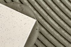 Close-up detail of floor tiles installation. Home improvement, r Stock Photo