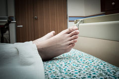 Close up detail of the foot of woman in hospital Stock Photography