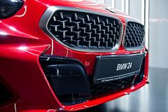 Close-up detail of front red metallic BMW Z4 sport car stock image