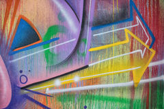 Close-up detail of graffiti painting. Arrows pointing sideway Stock Photos