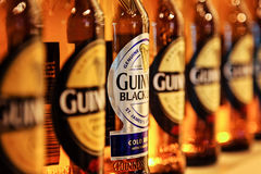 Close-up detail of guinness bottles in a row Stock Image