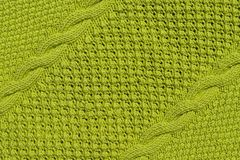 Abstract textured background of green knitting stock images
