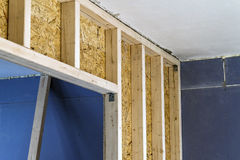 Close up detail of house construction wooden wall elements. Inte Stock Photography