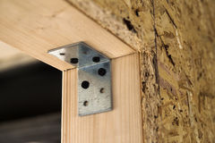 Close up detail of house construction wooden wall elements. Interior frame renovation work royalty free stock image