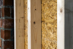 Close up detail of house construction wooden wall elements. Interior frame renovation work royalty free stock images