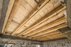 Close-up detail of house room interior under construction and renovation. Energy saving walls of hollow foam insulation blocks,. Wooden ceiling beams for roof stock photos