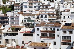 Close up detail of houses in Spanish white village of Mijas Pueb. A section of houses in the white village of Mijas Pueblo in the Malaga / Costa del Sol region royalty free stock images