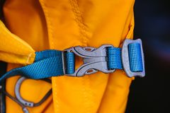 Close-up detail of locked blue convenient plastic clasp of backpack yellow. Accessory, Lock,Travel royalty free stock photos