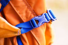 Close-up detail of locked blue convenient plastic clasp of backpack yellow. Accessory, Lock stock photo