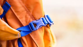 Close-up detail of locked blue convenient plastic clasp of backpack yellow. Accessory, Lock,Travel royalty free stock photography