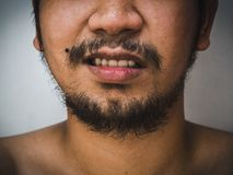 Close up detail of male mouth have beard and mustache , monochrome tone stock photography