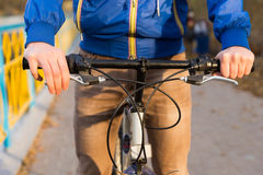 Close up detail of a man riding a bicycle Stock Photography