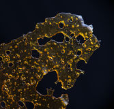 Close up detail of marijuana oil concentrate aka shatter isolate Stock Photography