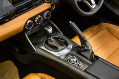 Close up of detail modern luxury car Interior - steering wheel, shift lever and dashboard. And air conditioner Royalty Free Stock Photo