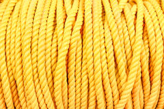 Close up detail of nautical industrial marine yellow coil rope Royalty Free Stock Image