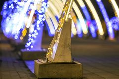 Close-up of New Year holiday decoration element on the street of a city. Royalty Free Stock Photos