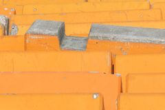 Close up detail of orange concrete road barriers. royalty free stock photography