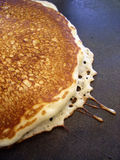 Close up detail of pancake. Cooking on electric skillet griddle Stock Photography